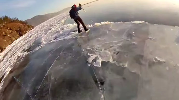 Risk-taking Siberian skier plunges into icy Lake Baikal, captured on GoPro camera