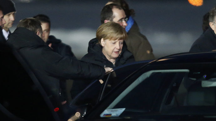 German Chancellor Angela Merkel gets into a car upon her arrival at Moscow's Vnukovo airport February 6, 2015. (Reuters/Sergei Karpukhin)
