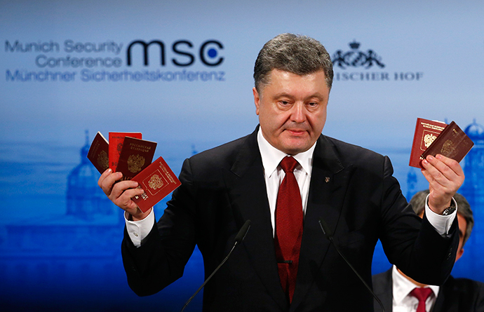 Ukraine's President Petro Poroshenko holds what he claims to be Russian passports proving the presence of Russian troops in Ukraine. Munich, February 7, 2015. (Reuters / Michael Dalder)