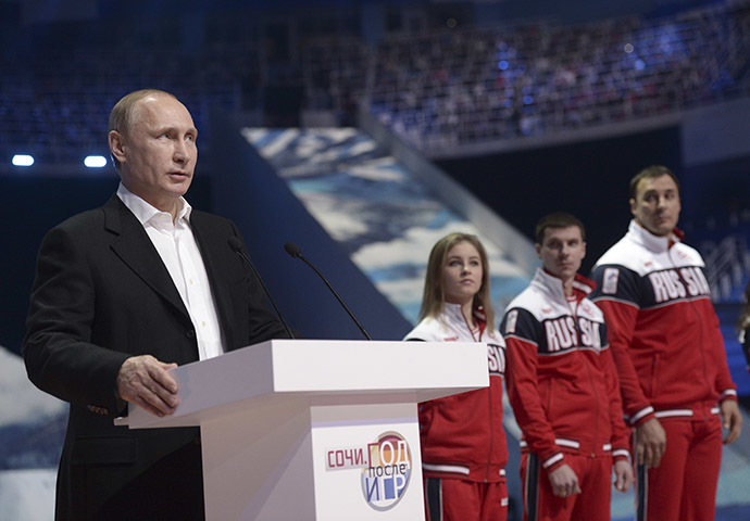 Russia's President Vladimir Putin (L) delivers a speech as he attends a show, dedicated to the first anniversary of the opening of the 2014 Sochi Winter Olympic Games, at the Iceberg Skating Palace in Sochi February 7, 2015. (Reuters/Alexei Nikolskyi/RIA Novosti)