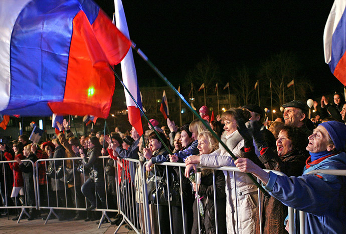 Simferopol residents on the central square watching celebratory fireworks after the ascension of Crimea into the Russian Federation. (RIA Novosti/Taras Litvinenko)