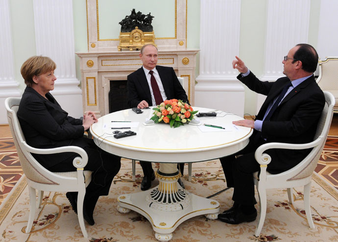 February 6, 2015. Russian President Vladimir Putin, Federal Chancellor of Germany Angela Merkel and President of France Francois Hollande, right, during a meeting in Kremlin. (RIA Novosti/Michael Klimentyev)