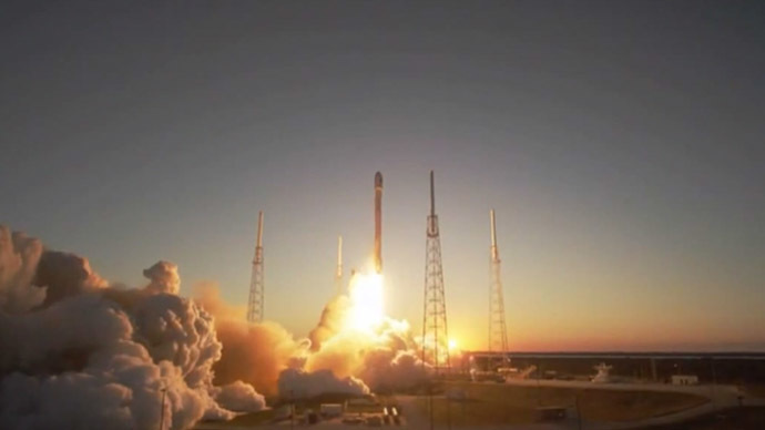 SpaceX launches Falcon 9 on third try, 'soft-lands' reusable stage in ocean (VIDEO)