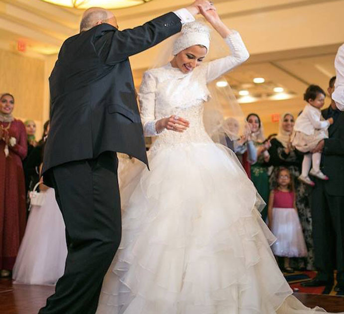 Yusor Mohammad Abu-Salha dancing with her father at her wedding. Photo from facebook.com