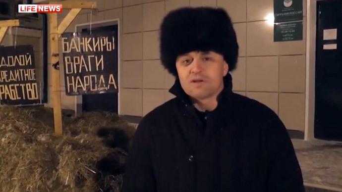 'People's enemies!': Broke Siberian farmer avenges 'debt slavery' by dumping manure outside bank