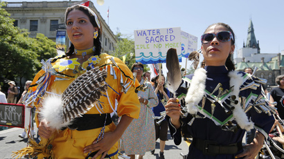 ARCHIVE PHOTO: First Nations protesters take part in a march to mark National Aboriginal Day in Ottawa June 21, 2013. (Reuters / Chris Wattie)