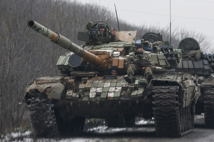 Donetsk rebels ride on a tank in Vuhlehirsk, Donetsk region February 6, 2015. (Reuters/Maxim Shemeto)
