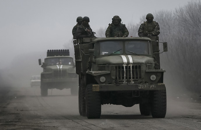 Members of the Ukrainian armed forces ride on a military vehicle near Artemivsk, eastern Ukraine. (Reuters/Gleb Garanich)