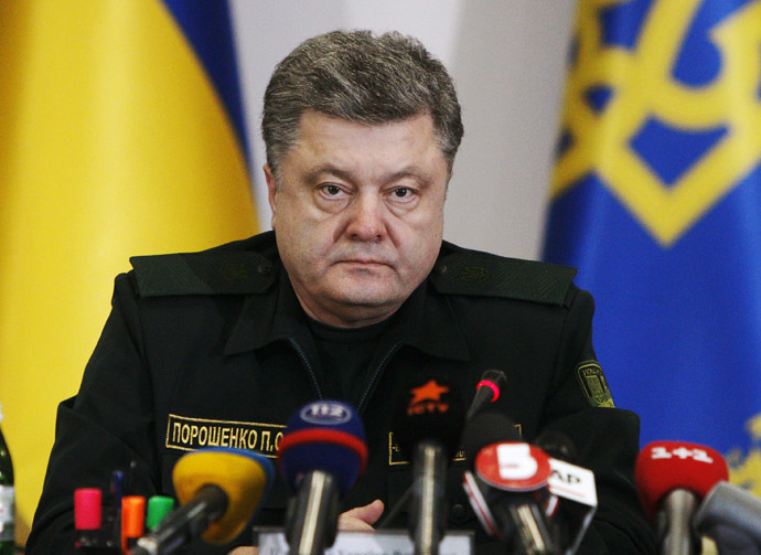Ukraine's President Petro Poroshenko talks to military staff in Kiev February 14, 2015. (Reuters/Valentyn Ogirenko)
