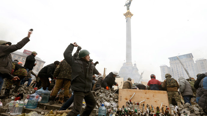 Anti-government protesters throw stones towards Interior Ministry members and riot police in Independence Square in central Kiev February 19, 2014.(Reuters / Vasily Fedosenko)
