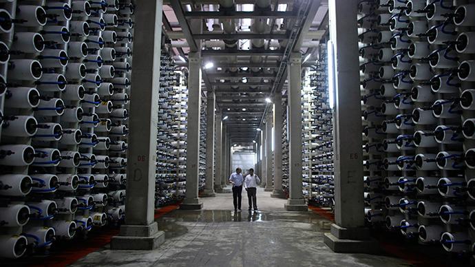 People walk in a desalination plant (Reuters / Nir Elias)