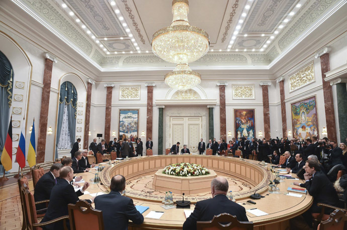 Members of delegations from Russia, Ukraine, Germany and France take part in peace talks on resolving the Ukrainian crisis in Minsk, February 11, 2015. (Reuters/Kirill Kudryavtsev)