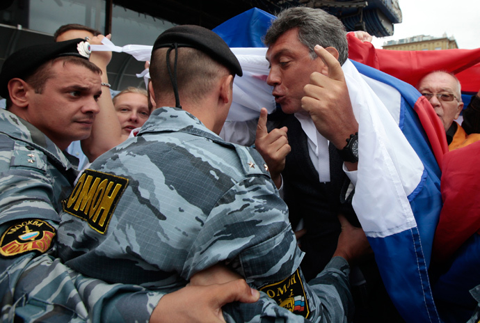 OMON police officers prevent participants from attending a rally staged on Moscow's Novy Arbat Street to commemorate August 1991 coup attempt. Foreground right: Solidarity movement leader Boris Nemtsov, 2010 (RIA Novosti / Ruslan Krivobok)