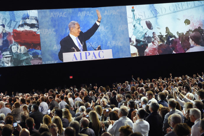 Israel's Prime Minister Benjamin Netanyahu is shown on a video screen as he waves at the end of his remarks to the American Israel Public Affairs Committee (AIPAC) policy conference in Washington, March 2, 2015. (Reuters/Jonathan Ernst)
