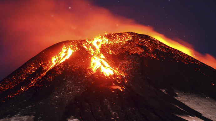 Ash and lava spew from the Villarrica volcano, as seen from Pucon town in the south of Santiago, March 3, 2015. (Reuters / Lautaro Salinas)
