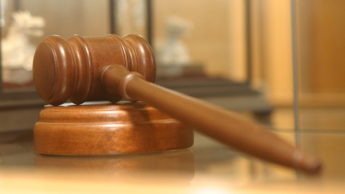 Ferguson judge known for aggressive fines owes IRS $170,000