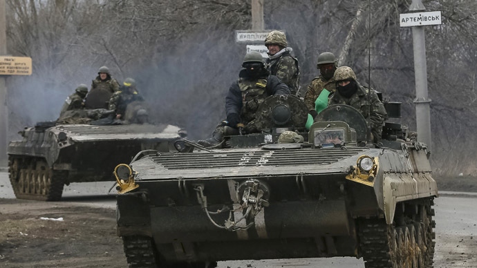 Members of the Ukrainian armed forces ride on armoured personnel carriers near Artemivsk, eastern Ukraine, March 3, 2015. (Reuters/Gleb Garanich)