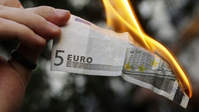 Euro spirals toward 1:1 parity with USD