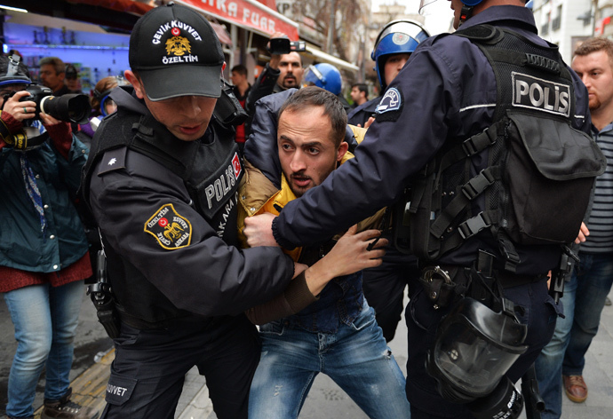 Riot police detain a demonstrator during a protest in Ankara March 11, 2015. (Reuters / Stringer)