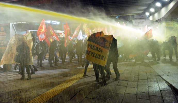 Riot police use water cannon to disperse demonstrators during a protest in Ankara March 11, 2015. (Reuters / Stringer)
