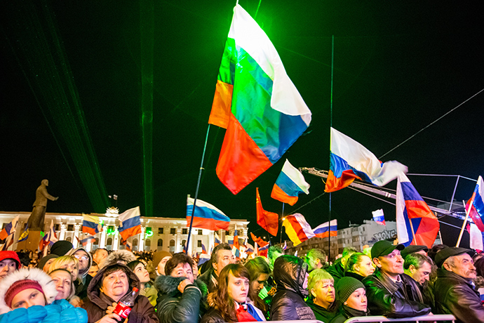 "Simferopol residents attending the ""Crimea-Spring"" concert on Lenin Square in the city center on the day of voting in a referendum about the status of Crimea (RIA Novosti)"