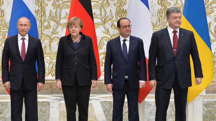 February 11, 2015. From left: Russian President Vladimir Putin, German Chancellor Angela Merkel, French President Francois Hollande and Ukrainian President Petro Poroshenko pose for a group photo at Independence Palace in Minsk after restricted attendance peace talks on Ukraine held by the Russian, German, French and Ukrainian leaders.(RIA Novosti / Viktor Tolochko)