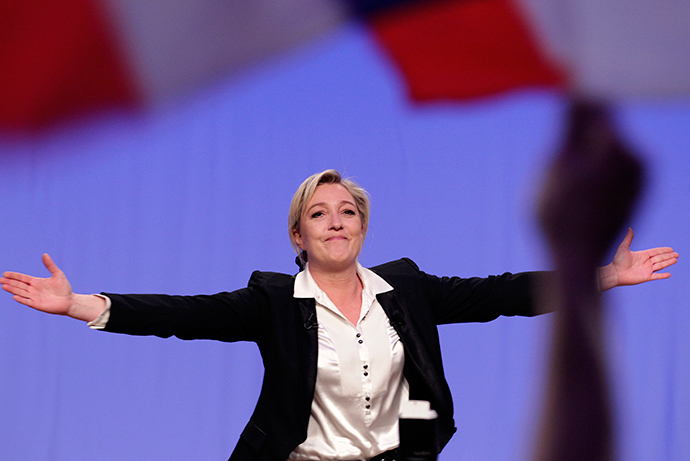 France's far right presidential candidate and National Front party president Marine Le Pen waves as she arrives to deliver a speech at a political rally in Strasbourg, February 12, 2012 (Reuters / Vincent Kessler)