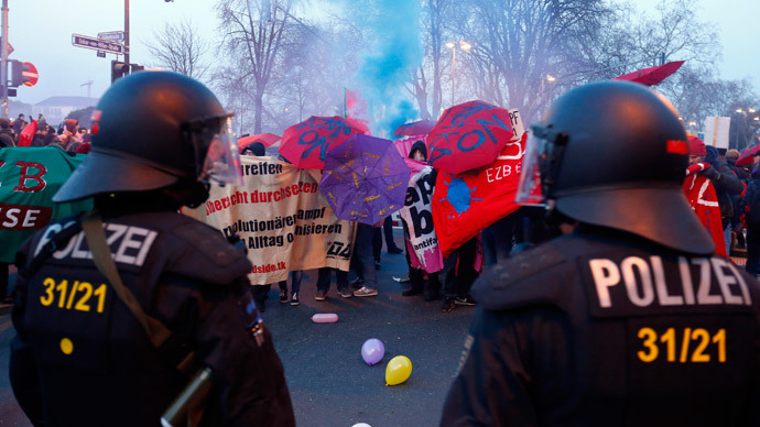 Anti-capitalist 'Blockupy' protesters stand in front of a police cordon near the European Central Bank (ECB) building before the official opening of its new headquarters in Frankfurt March 18, 2015. (Reuters / Michael Dalder )