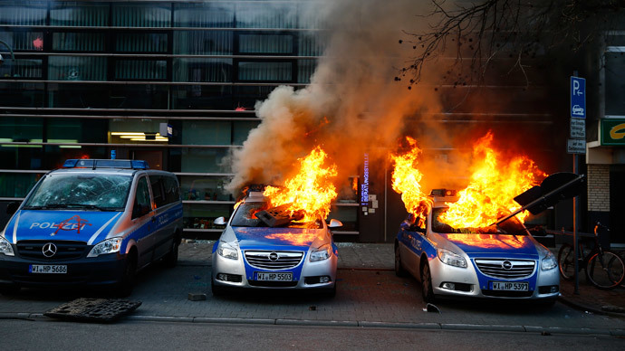 German police cars set on fire by anti-capitalist protesters burn outside the European Central Bank (ECB) building hours before the official opening of its new headquarters in Frankfurt March 18, 2015. (Reuters / Kai Pfaffenbach)