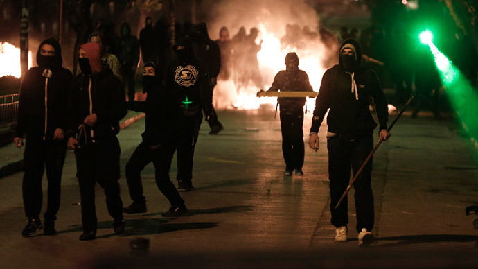Greek protesters target police, torch cars in Athens demanding prison closure