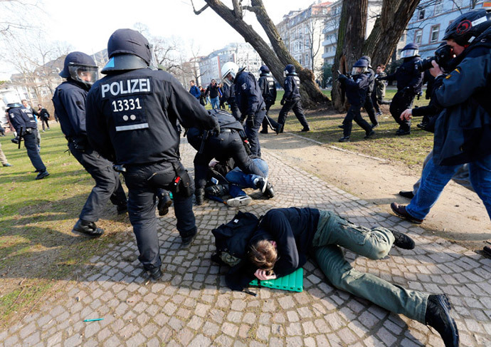 Policemen detain members of 'Blockupy' anti-capitalist movement near the European Central Bank (ECB) building before the official opening of its new headquarters in Frankfurt March 18, 2015. (Reuters / Michael Dalder)