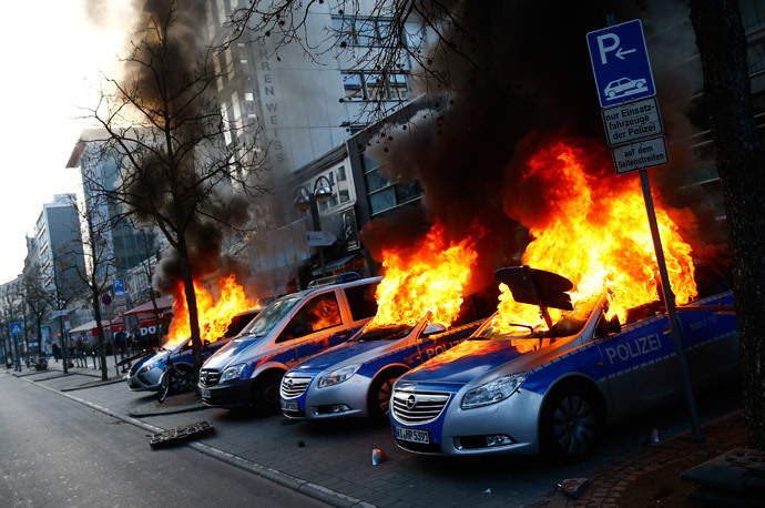 Four German police cars set on fire by anti-capitalist protesters burn near the European Central Bank (ECB) building hours before the official opening of its new headquarters in Frankfurt March 18, 2015. (Reuters / Kai Pfaffenbach)