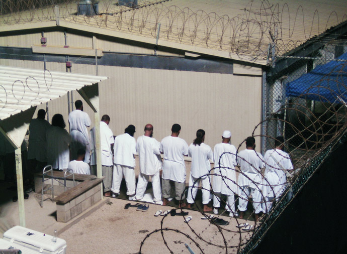 Detainees participate in an early morning prayer session at Camp IV at the detention facility in Guantanamo Bay U.S. Naval Base. (Reuters / Deborah Gembara)