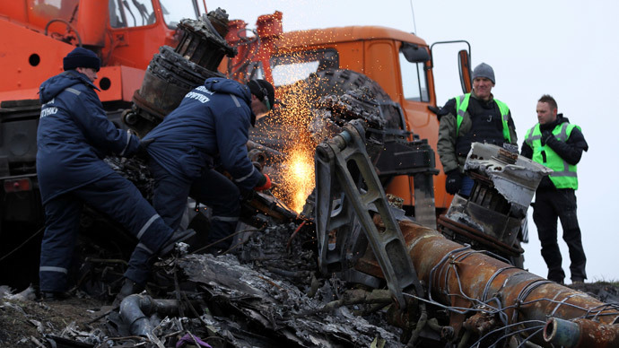 Local workers cut wreckage of the Malaysia Airlines Boeing 777 plane (flight MH17) at the site of the plane crash near the settlement of Grabovo in the Donetsk region November 16, 2014.(Reuters / Antonio Bronic)