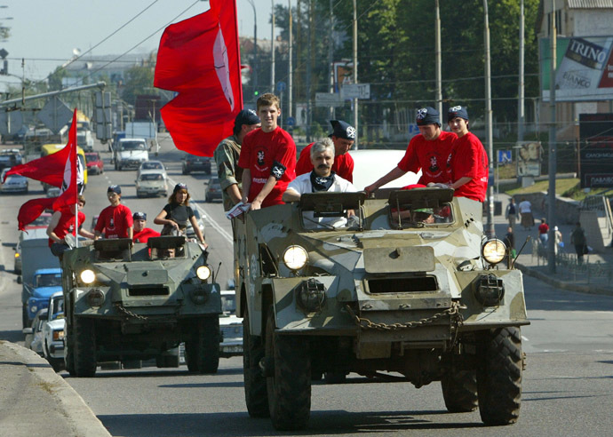 Representatives of the Ukrainian Radical Brotherhood movement and their leader Dmytro Korchynsky (2L) ride armoured personnel carriers towards the Central Election Commission in Kiev, July 19, 2004. (Reuters / Stringer)