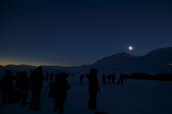 People look at a total solar eclipse on Svalbard March 20, 2015. (Reuters / Haakon Mosvold Larsen)