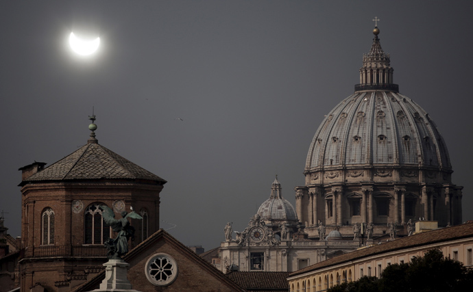 A partial solar eclipse is seen over St.Peter's Basilica in Rome March 20, 2015.(Reuters / Yara Nardi)
