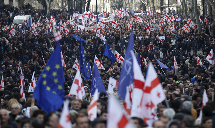 Opposition supporters march on the street during a rally organised by the United National Movement, calling for the resignation of the government in Tbilisi, March 21, 2015. (Reuters / David Mdzinarishvili)
