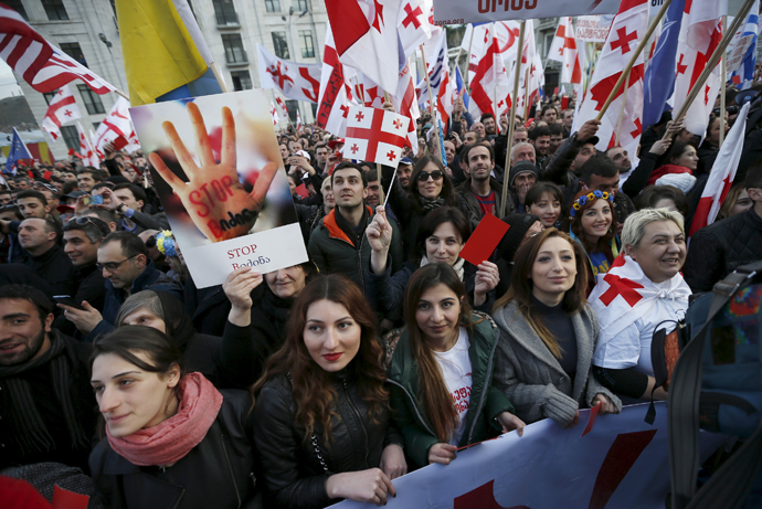 Opposition supporters attend a rally organised by the United National Movement, calling for the resignation of the government, in Tbilisi, March 21, 2015. (Reuters / David Mdzinarishvili)