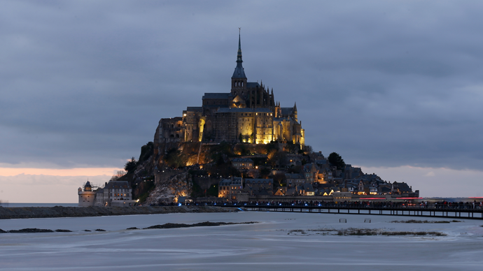 'Tide of century': Thousands flock to ancient French abbey for rare supertide