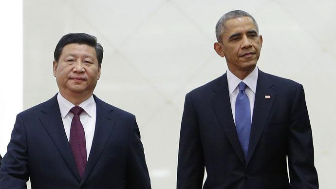 China's President Xi Jinping (L) walks next to U.S. President Barack Obama (R) (Reuters/Jason Lee)