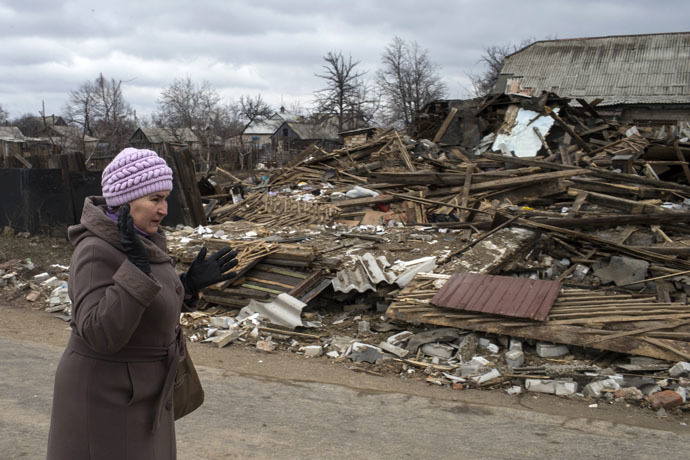 A woman reacts as she passes a destroyed house in the town of Debaltseve, north-east from Donetsk, March 17, 2015. (Reuters/Marko Djurica)