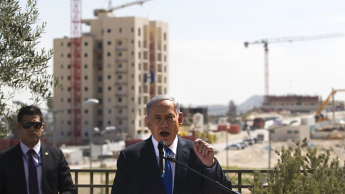 Israeli Prime Minister Benjamin Netanyahu delivers a statement in front of new construction in the Jewish settlement known to Israelis as Har Homa and to Palestinians as Jabal Abu Ghneim in an area of the West Bank that Israel captured in a 1967 war and annexed to the city of Jerusalem, March 16, 2015. (Reuters/Ronen Zvulun)