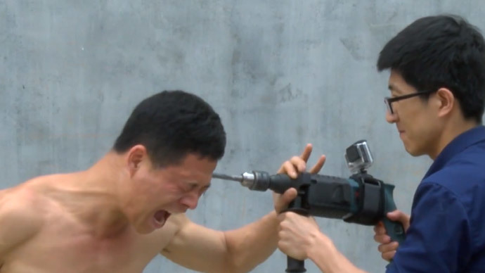 A man of steel & stone: Shaolin Kung-Fu master uses electric drill on his skull (GRAPHIC VIDEO)