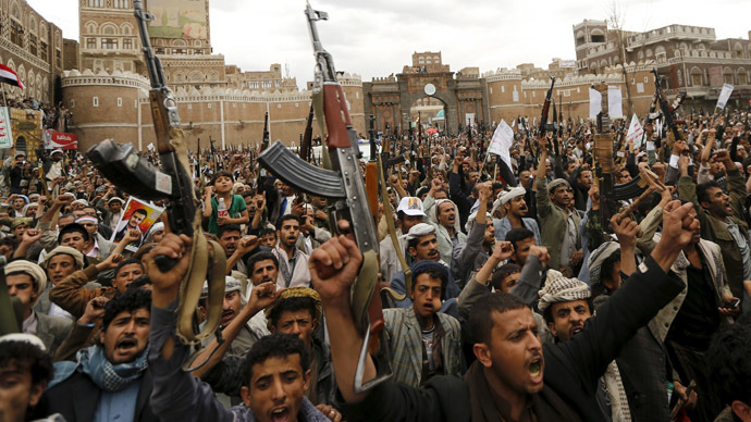Shi'ite Muslim rebels hold up their weapons during a rally against air strikes in Sanaa March 26, 2015. (Reuters/Khaled Abdullah)