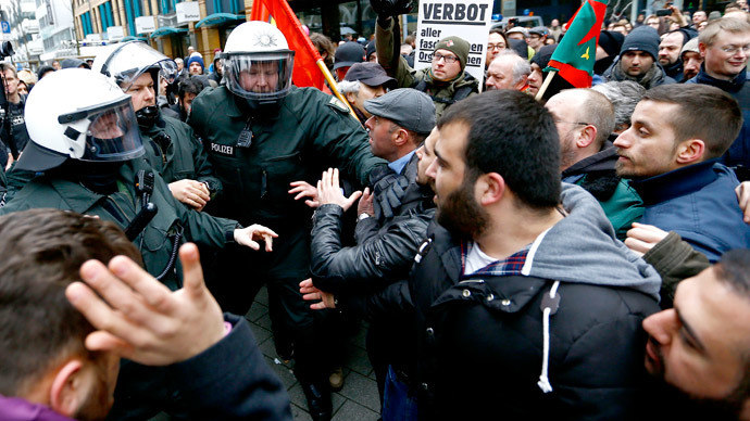 German riot police officers confront anti-Salafist protestors during a demonstration again extremist Muslim Salafists in Wuppertal March 14, 2015.(Reuters / Kai Pfaffenbach)