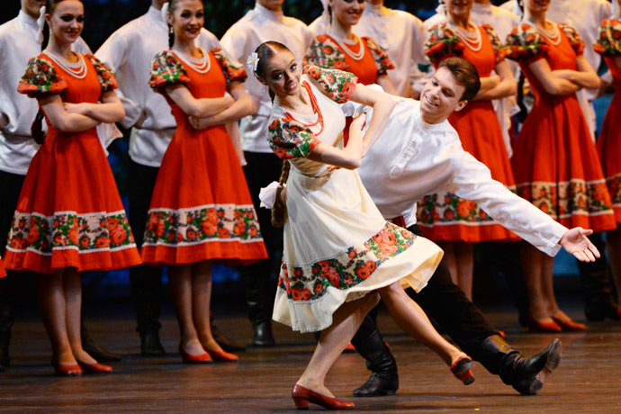 "Members of the Igor Moiseyev Folk Dance Company perform the Russian dance entitled ""Summer"" at the Bolshoi Theatre in Moscow. (RIA Novosti / Vladimir Vyatkin)"