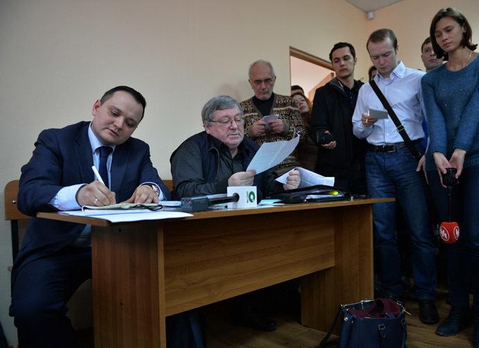 "Second left: Boris Mezdrich, Director of the Novosibirsk Opera and Ballet Theater, and his lawyer attend court session hearing the case of Timofei Kulyabin, the stage director of the opera ""Tannhauser."" Earlier, a prosecutor's office opened administrative cases against Mezdrich and Kulyabin in connection with the ""desecration of church utensils,"" to quote Metropolitan Tikhon of Novosibirsk and Berdsk. (RIA Novosti/Alexandr Kryazhev)"