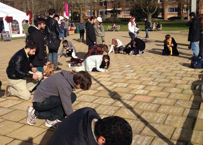 Sussex students write the names of more than 2,000 Palestinian victims of Israel's military operation in Gaza last summer. (Credit: Sussex Friends of Palestine Society)