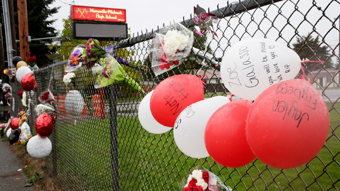 Washington school shooter's dad faces felony charges for illegal gun